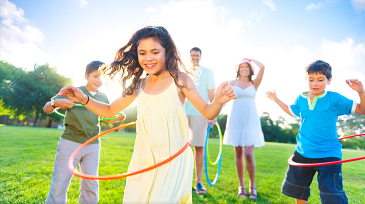 Kids playing with hula hoops.